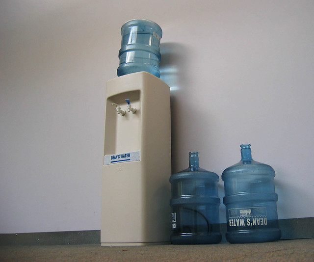 water cooler with two extra gallons of water