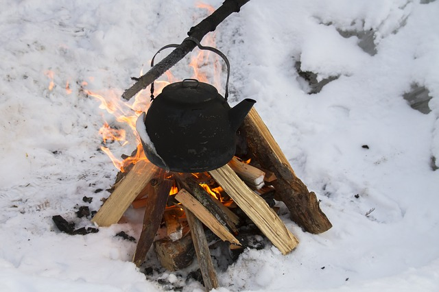 a kettle over a firewood
